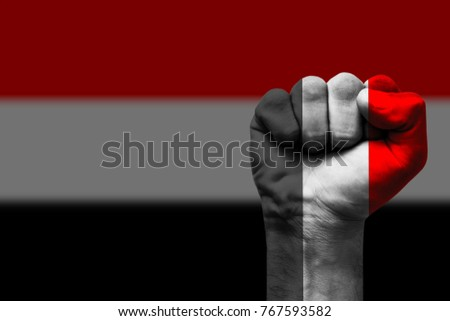 Fist painted in colors of Yemen flag, fist flag, country of Yemen