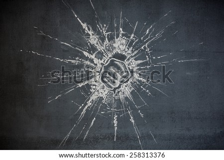 fist punching through glass breaking through illustration on a chalk board background showing power and strength - stock photo