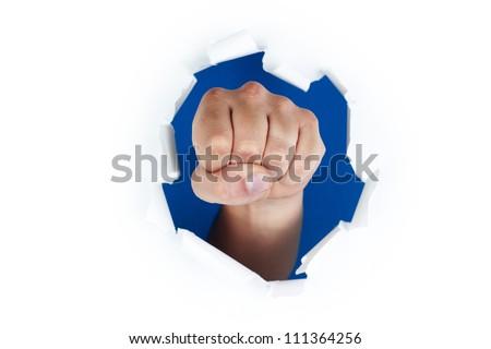 Fist through paper - stock photo