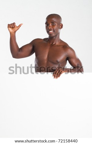 fit african american man behind white board giving thumb up - stock photo