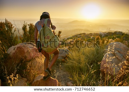 fit african american woman hiking trail near san diego california