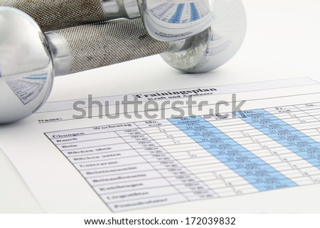 fit and healthy with workout plan and dumbbell - stock photo