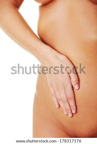 Fit and slim young woman belly with hand on it - stock photo