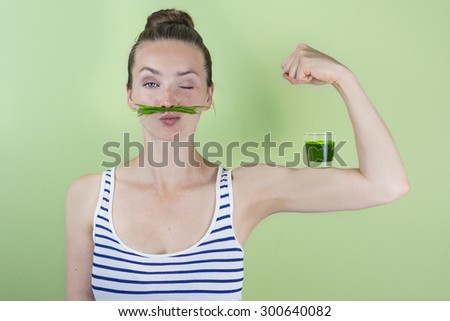 Fit and strong with wheat grass juice - stock photo