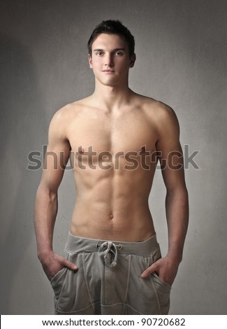 Fit bare-chested young man - stock photo