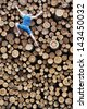 Fit climber going down the large pile of cut wooden logs - stock photo