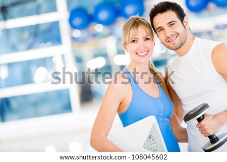 Fit couple at the gym looking very attractive - stock photo