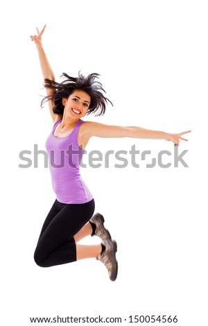 Fit excited young woman jumping in happiness up in the air - isolated on white.  - stock photo