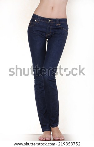 Fit female body in blue jeans - stock photo