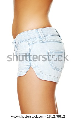 Fit female butt in jeans shorts - stock photo
