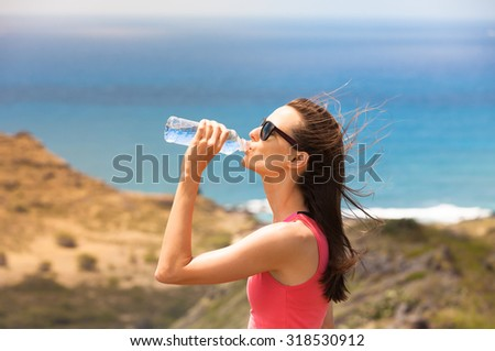 Fit female drinking water.  - stock photo