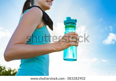 Fit female with bottle of water.  - stock photo