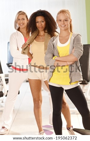Fit girls standing and smiling at the gym. - stock photo