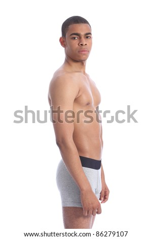 Fit healthy toned body of handsome young African American man wearing grey jockey underwear only, naked upper torso showing off pectorals muscles. - stock photo