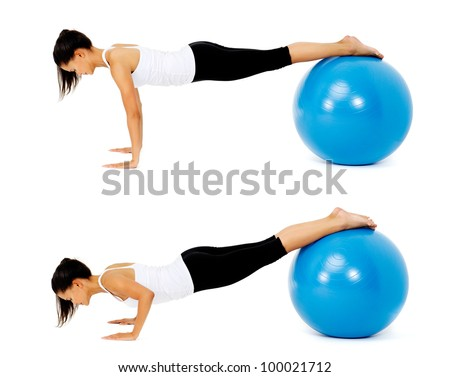 Fit healthy woman uses pilates gym ball as part of toning and muscle building training exercise. isolated on white, see portfolio for more in this series.