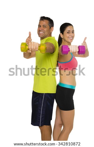 Fit Hispanic couple doing lateral raise and thumbs up - stock photo