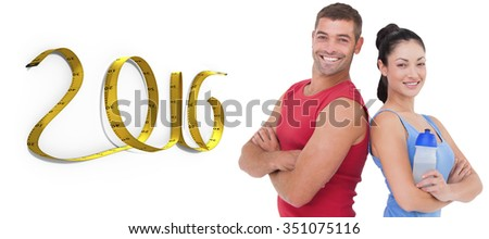 Fit man and woman smiling at camera together against white background with vignette - stock photo
