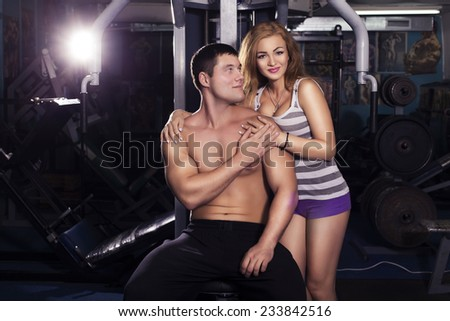 fit man and woman trains in gym. indoors