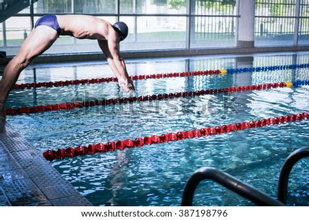 Fit man diving in the pool