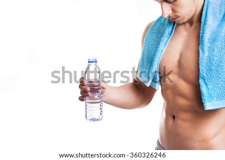 Fit man holding a bottle of water, isolated on white background - stock photo
