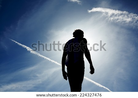 Fit man in sportswear enjoying the sun taking break after run - stock photo