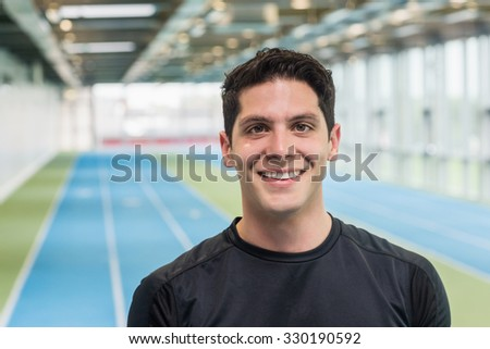Fit man on the running track at the gym - stock photo