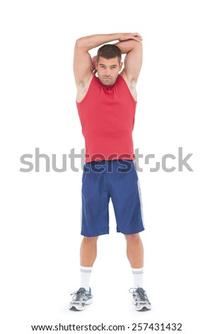 Fit man stretching his arms on white background - stock photo