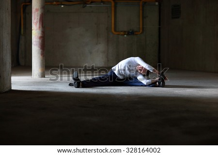 fit man stretching in dark space - stock photo