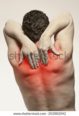 Fit man with shoulder and back pain isolated injury  - stock photo