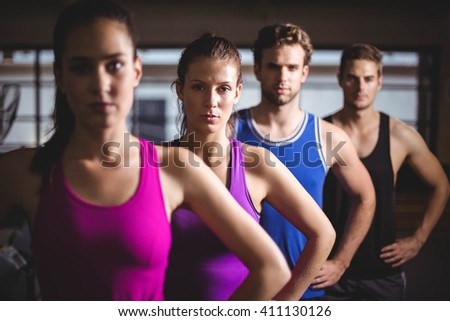 Fit people with hands on hips at gym - stock photo