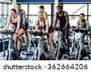 Fit people working out at class in the gym - stock photo