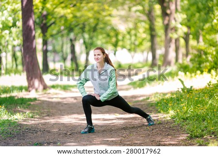 Fit sportive women stretching in the park. Healthy life and fitness concept