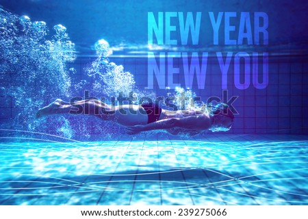 Fit swimmer training by himself against new year new you - stock photo