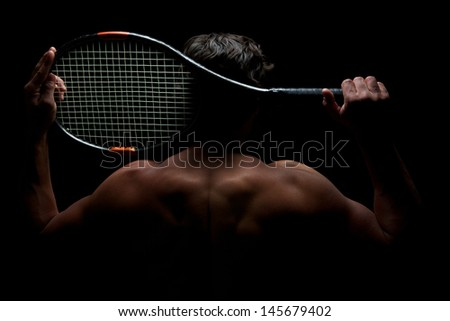 Fit Tennis Player and his Racket - stock photo