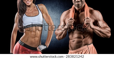 Fit woman and man showing her perfect abs - stock photo