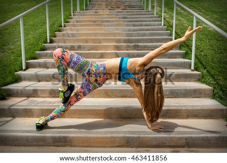 Fit woman doing exercise on the stairs outdoor