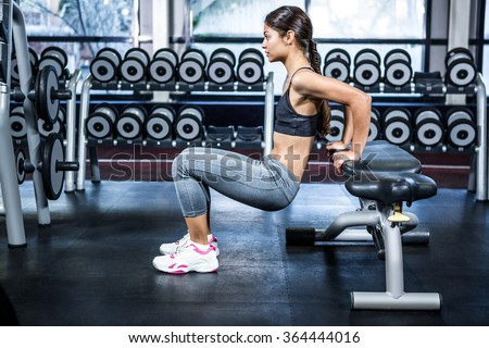 Fit woman doing fitness exercises at the gym - stock photo
