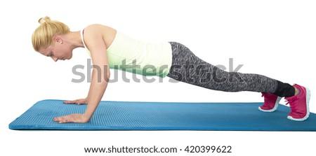 fit woman doing push-ups - stock photo
