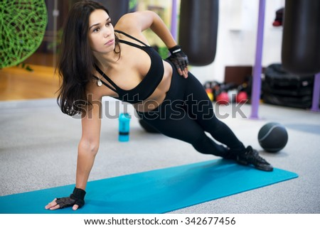 Fit woman doing side plank yoga pose Concept pilates fitness healthy lifestyle. - stock photo