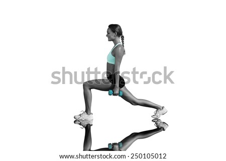 Fit woman doing weighted lunges on the beach against mirror - stock photo