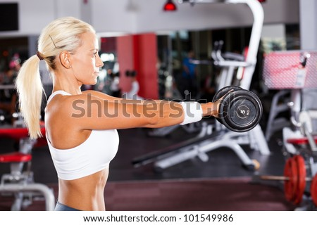 fit woman doing workout with dumbbell - stock photo