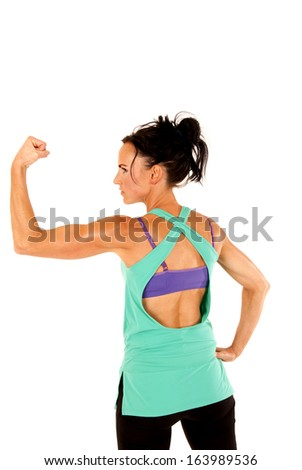 fit woman flexing one arm looking sideways