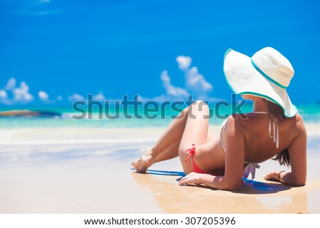 Fit woman in sun hat and bikini at beach.remote tropical beaches and countries. travel concept - stock photo