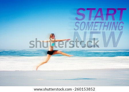 Fit woman jumping gracefully on the beach against start something new - stock photo