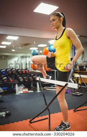 Fit woman measuring her jump at the gym