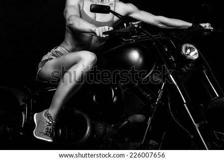 fit woman on a bike - stock photo