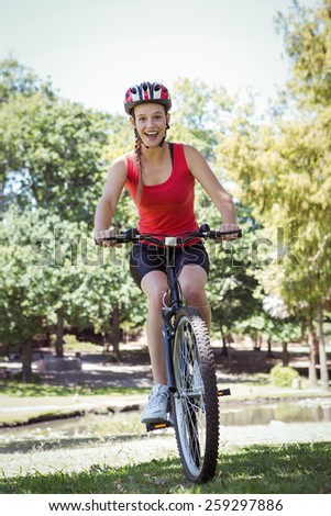 Fit woman riding her bicycle on a sunny day - stock photo