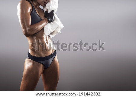 Fit woman sweating finishing the exercise - stock photo