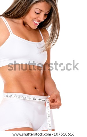 Fit woman taking measurements - isolated over a white background - stock photo