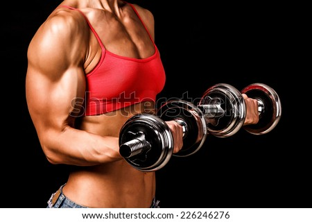 Fit woman with barbells, isolated on black  - stock photo